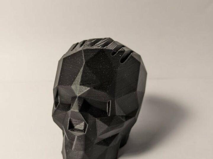 Skull guitar pick holder