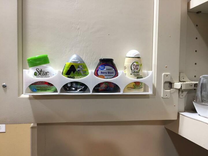 Cabinet Rack for liquid water flavor enhancer bottles