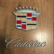 Cadillac emblem and text.jpg