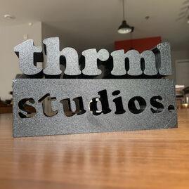 THRMLStudios logo